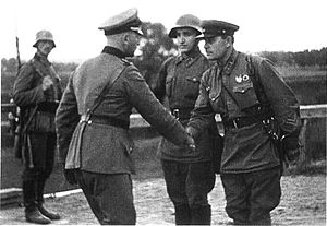 A German and a Soviet officer shaking hands at...