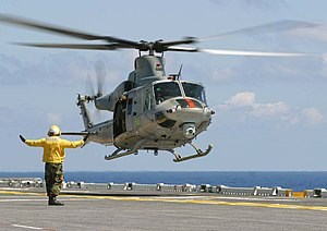 English: UH-1Y Huey helicopter landing on ship