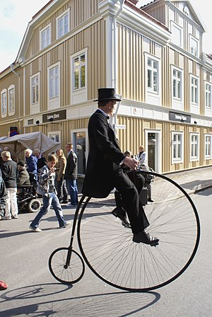 Old man on :Penny-farthing