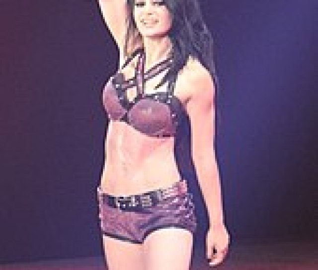 Paige Posing Just After Winning The Divas Championship At Her Main Roster Debut In April 2014