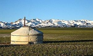 Yurt with the Gurvansaikhan Mountains behind, ...