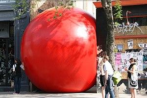 A big red ball stuck down an alley off Queen S...