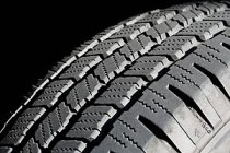 An automotive tire tread typically ranges from...