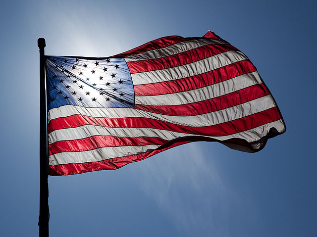 American flag backlit waving