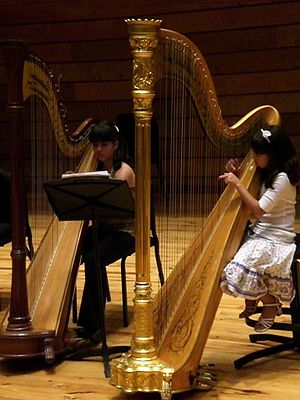 English: Two girls playing the classic harp, C...