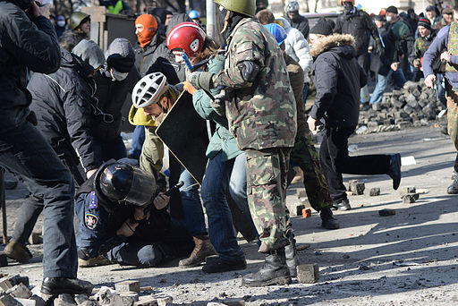 A police officer attacked by protesters during clashes in Ukraine, Kyiv. Events of February 18, 2014-1