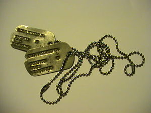 English: USMC military ID tag (dog tag) with r...
