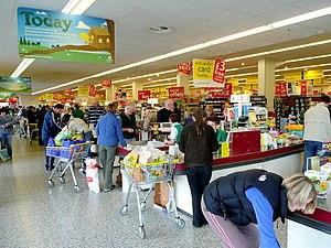 English: Saturday morning shoppers The check-o...