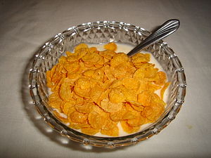 Corn flakes can be eaten with yogurt or milk.