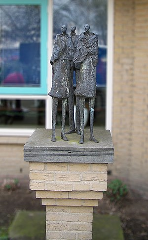 English: Sculpture of three people with blanke...