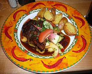 English: Kangaroo steak with glazed apples, cr...