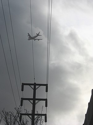 A commercial aircraft flying into the clouds o...