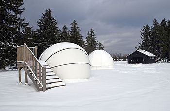 English: Snow covers the astronomy domes at Ch...