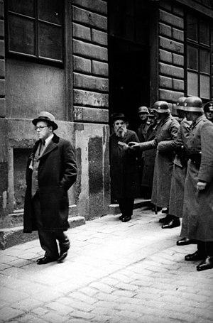 The SS raid a Jewish community center, Vienna,...