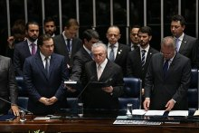 Michel Temer takes the presidential oath of office during his inauguration in the National Congress, 31 August 2016.