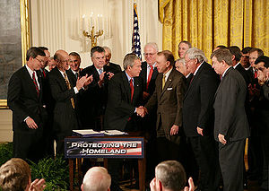 United States President George W. Bush shakes ...