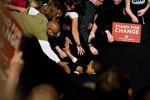 English: Barack Obama shakes hands with suppor...