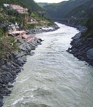 The turbulent Bhagirathi river (foreground) on...