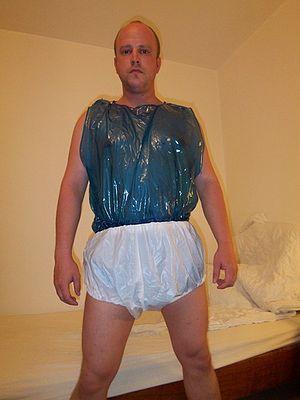 English: Diaper fetishist in a pvc diaper