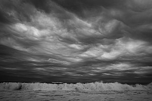 English: Overcast skies from offshore Tropical...