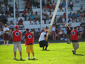 Tossing the caber at the Glengarry Highland Ga...