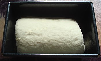 Bread dough in tin. Needs to rise before going...