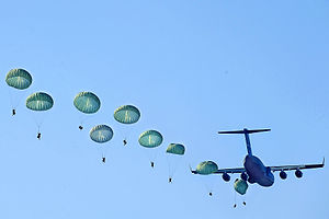 U.S. Army Rangers parachute from a U.S. Air Fo...