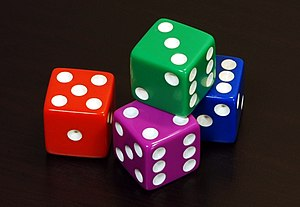 Four coloured 6 sided dice arranged in an aest...