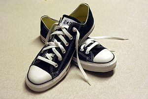 A pair of black Converse sneakers
