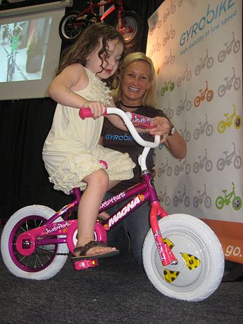 English: Stay stable riding a bike at slow spe...