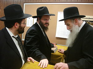 Rabbis Brown and Mayer talking with Rabbi Ahar...