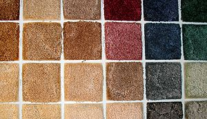 Swatches of carpet of tufted construction