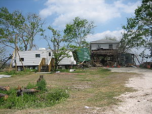 FEMA trailer and Katrina damaged house in St. ...