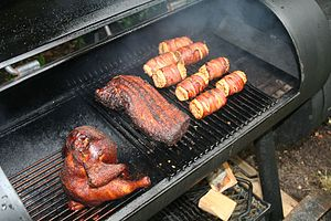 Some chicken, pork and corn in the barbeque