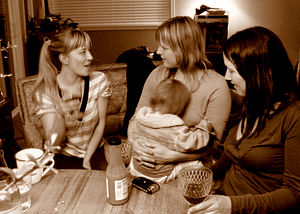 three women and child, friendly conversation, ...