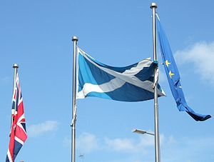 Flags outside the Scottish Parliement in Edinb...