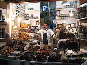 Date seller in the old souq in Kuwait City, su...