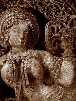 Lady looking into mirror, Belur Halebidu