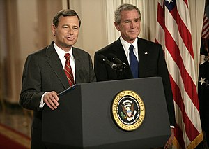 President George W. Bush looks on as his nomin...