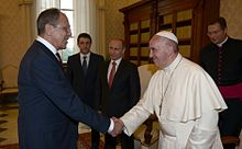 Pope Francis shaking hands with Russian Foreign Minister Sergey Lavrov, behind Russian President Vladimir Putin, 10 June 2015