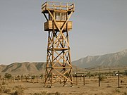 Replica of an historic watch tower at the Manzanar National Historic Site, built in 2005.  Eight watchtowers, equipped with searchlights and machine guns pointed inward at the prisoners, were positioned around the perimeter of the camp. April 27, 2007.