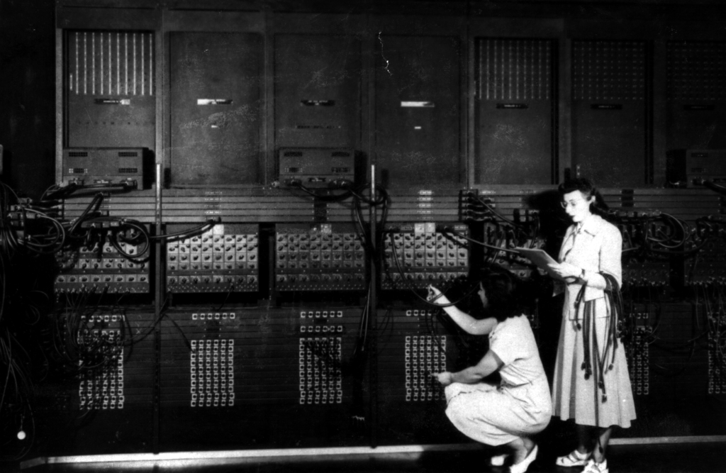 Two women wiring the right side of the ENIAC with a new program.