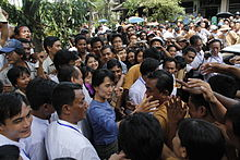 Aung San Suu Kyi greeting supporters from Bago State in 2011