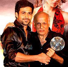 Emraan Hashmi is posing with Mahesh Bhatt