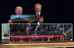 President Carter holding a model of the ship t...