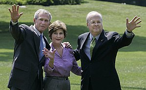 President George W. Bush stands with Mrs. Laur...