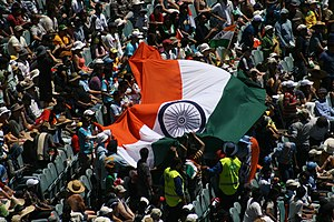 English: Fans wave the Indian flag during a ma...