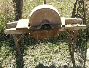 Hand operated grinding stone