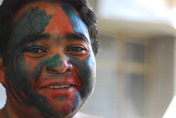 Holi celebrations in a college (Indian man dre...