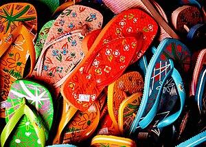 Assorted colorful flip-flops.